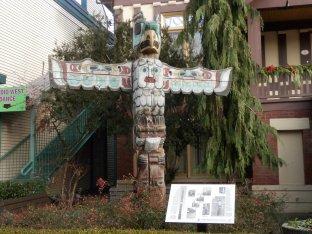 Totem pole outside Ladner Museum.